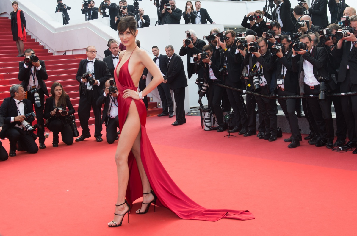 Bella Hadid in red satin at Cannes Film Festival. Photo: Getty