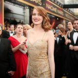 Emma Stone is the belle of the ball in gold Givenchy.