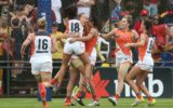 Greater Western Sydney's AFLW team celebrate a goal.