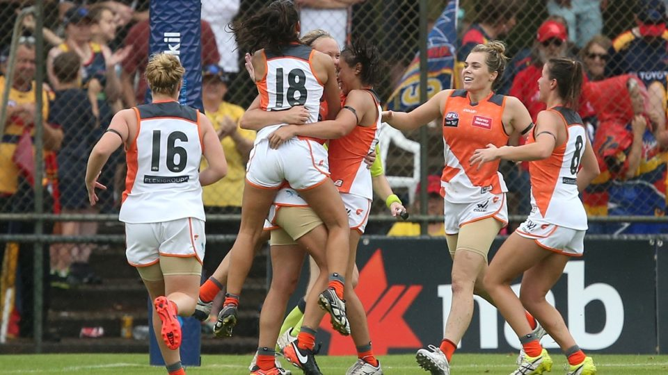 Greater Western Sydney's AFLW team celebrate a goal.