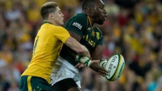 Then-Wallaby James O'Connor (left) tackles South Africa's Tendai Mtawarira in 2013.