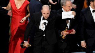La La Land producer Jordan Horowitz holds up the winning envelope with 'Moonlight' as Best Picture.