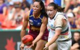 Leah Kaslar of the Brisbane Lions (left) and Sarah Perkins of the Adelaide Crows compete for the ball during the AFLW Grand Final game against the Adelaide Crows at Metricon Stadium in Carrara on the Gold Coast on Saturday. Photo: AAP.