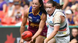 Kaslar and Perkins compete for the ball during the inaugural AFLW grand final. Photo: AAP.