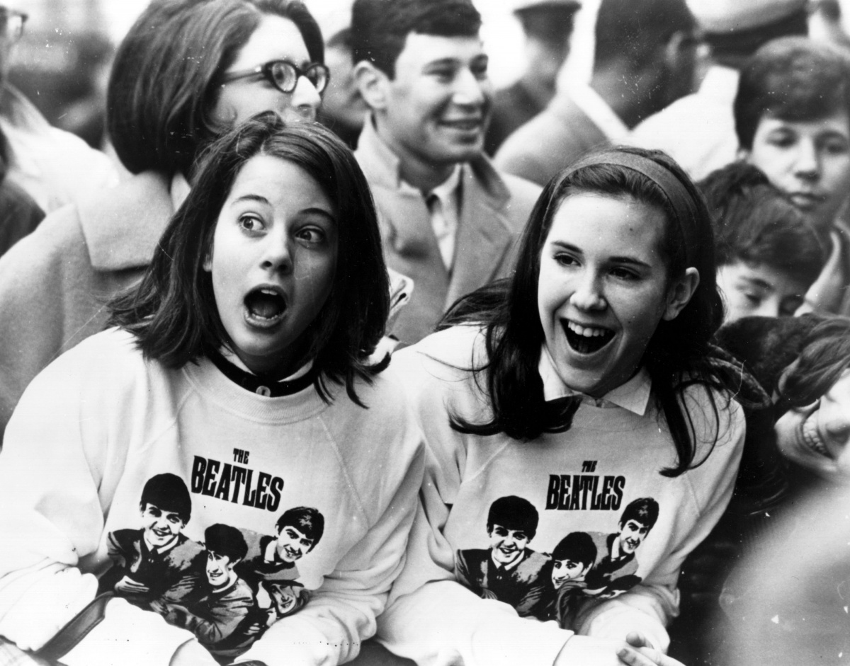 Fans gawk at the Beatles during the 1960s.