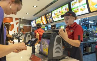 Some Brisbane-based McDonald's employees have been bullied into unpaid work.