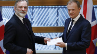 Britain's ambassador to the EU Tim Barrow (L) delivers notice of the UK's intention to leave to EC President Donald Tusk.