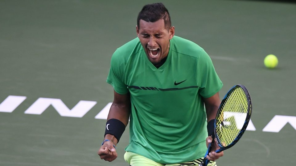 Nick Kyrgios roars in celebration after smashing Novak Djokovic in straight sets