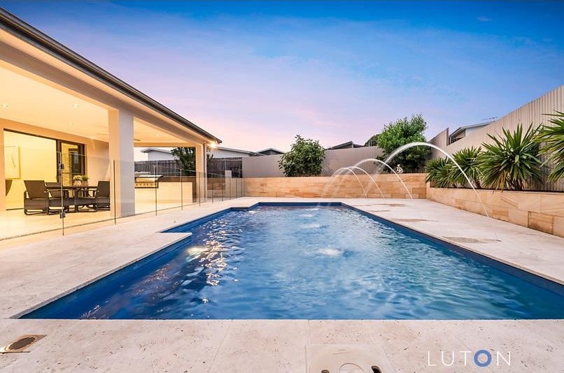The glistening backyard pool is one of the home's drawcards. Photo: Luton