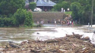 Lavenders Bridge in Bellingen is somewhere beneath the debris-strew torrent of the Bellingen River.