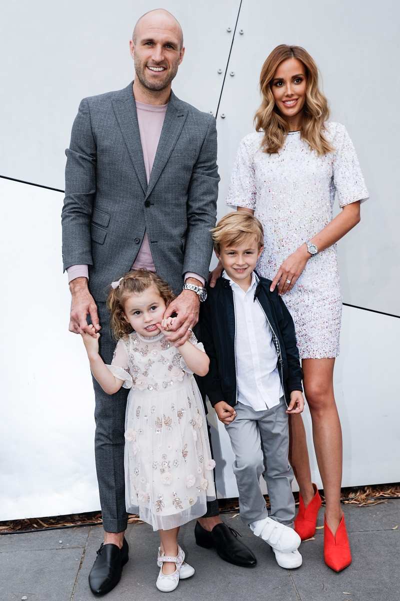Chris and Bec Judd and their kids hit the media wall. Photo: Getty