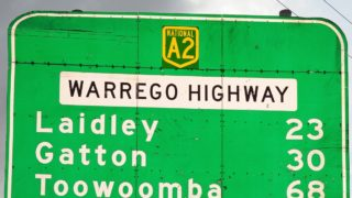The woman was rescued on the Warrego Highway at Mitchell, in south-west Queensland.