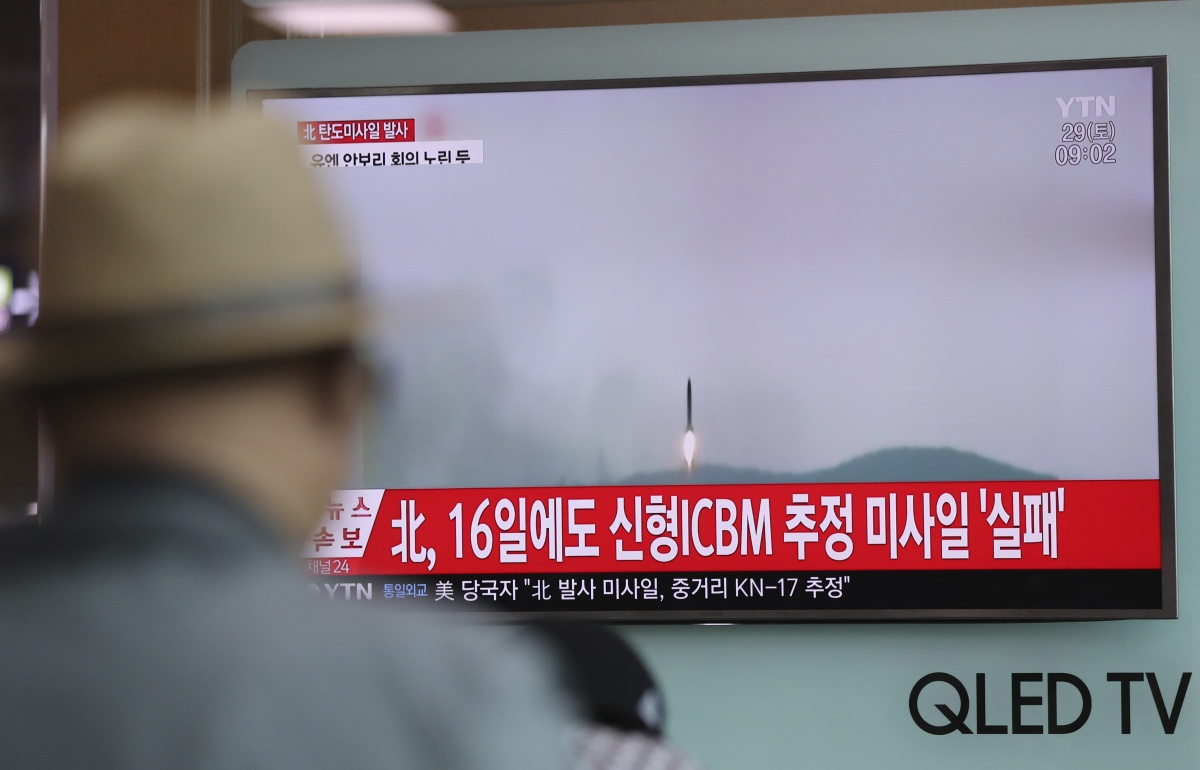 A South Korean man watches a TV news program about North Korea's latest missile test on Saturday. Photo: AAP