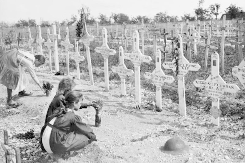French children tend to graves of Australians killed in battle