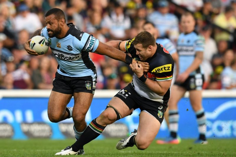 Jayson Bukuya (left) of the Sharks is tackled by Trent Merrin of the Panthers