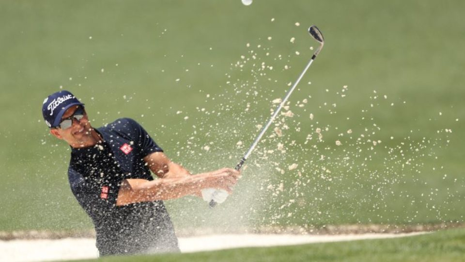 Australia's Adam Scott blasts out of a bunker on his way to another birdie during an inspired third round at the Masters in Augusta.