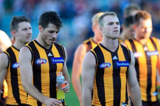 No smiles and nothing to smile about as the Hawks leave the field after their humiliation at the hands of St Kilda .