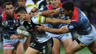 Jesse Bromwich (right) puts the handbrake on Nathan Cleary to foil yet another ill-fated Panthers bid for the try line.