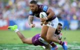 Manly's Dylan Walker is tackled by Joshua Addo-Carr of the Storm during the try-fest at Lotoland.