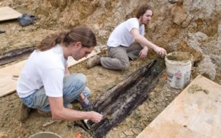 Exhuming remains unearthed during University road construction