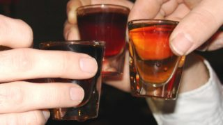teen drinking shots