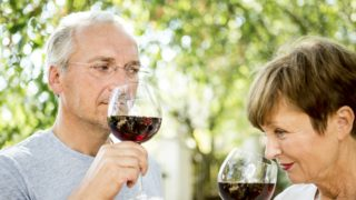 senior red wine couple