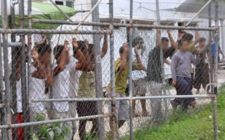 Manus Island detainees are pictured in 2014. Detainees received $70 million in a settlement