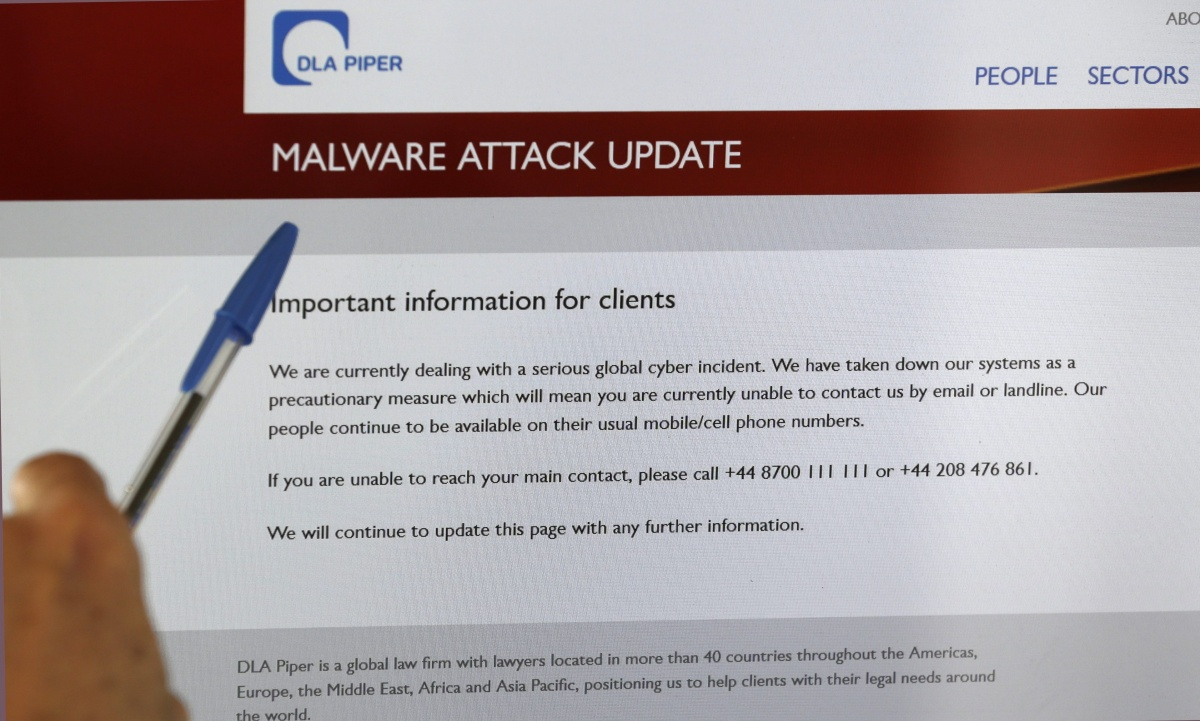 A screen displays the website of the global law firm DLA Piper showing a message about a malware attack advising readers that their computer systems have been taken down as a precautionary measure due to what they describe as a serious global cyber incident, as seen from Launceston, Tasmania