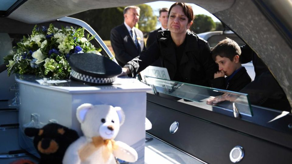 Brett Forte's family farewell his casket