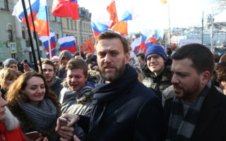 Russian opposition leader Alexei Navalny attend a march marking the one-year anniversary of the killing of opposition leader Boris Nemtsov in Moscow, Russia