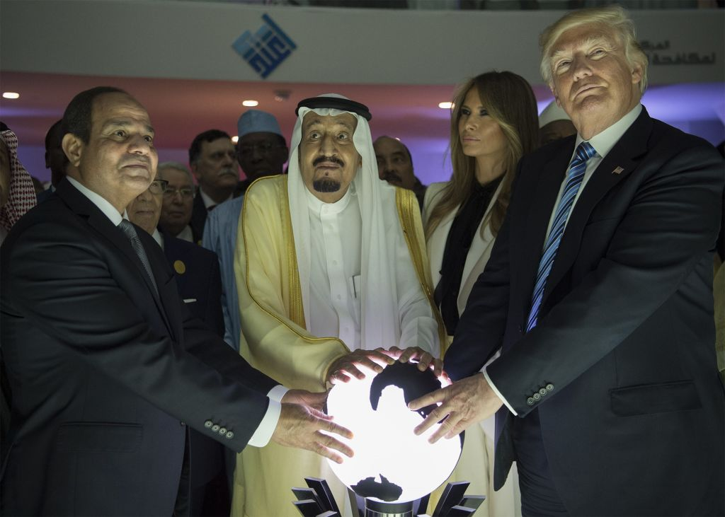 President Donald Trump, US First lady Melania Trump, Saudi Arabia's King Salman bin Abdulaziz al-Saud (2nd L) and Egyptian President Abdel Fattah el-Sisi (L) put their hands on an illuminated globe during the inauguration ceremony of the Global Center for Combating Extremist Ideology in Saudi Arabia in May