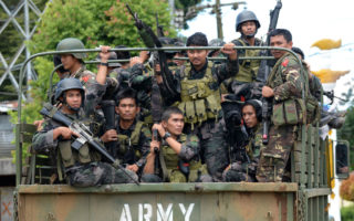 Members of the Philippine police special action force on their way to the frontline in Marawi on June 19, as the armed conflict between government troops and Islamist militants continues