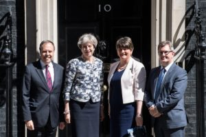Theresa May (C-L), and DUP leader Arlene Foster