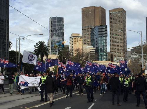 Police use pepper spray as left and rightwing protesters clash in Melbourne