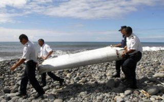A wing flaperon belonging to MH370 is washed up on Reunion Island, off the east of the African coastline, in July 2015
