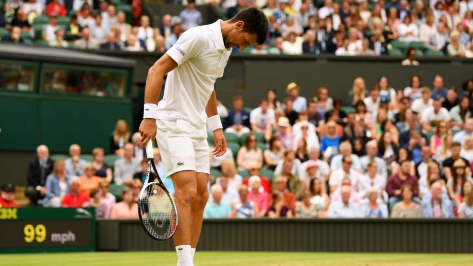 Djokovic hits out over delay after booking place in quarters