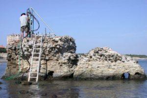 Drilling at a marine structure in Portus Cosanus