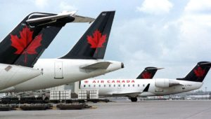 An Air Canada pilot almost landed on the wrong strip and could have crashed into four full passenger planes waiting for take-off on the taxiway