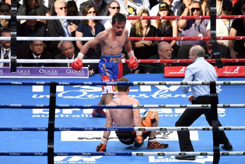 Jeff Horn (bottom) falls to the ground against Manny Pacquiao
