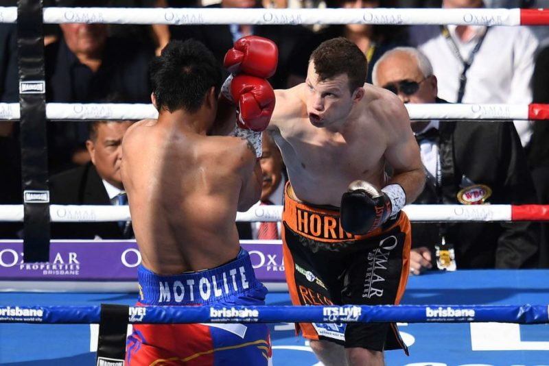 Jeff Horn (right) lands a punch on Manny Pacquiao