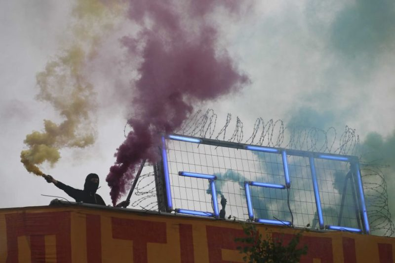 Protester holds flare at anti-G20 demonstration