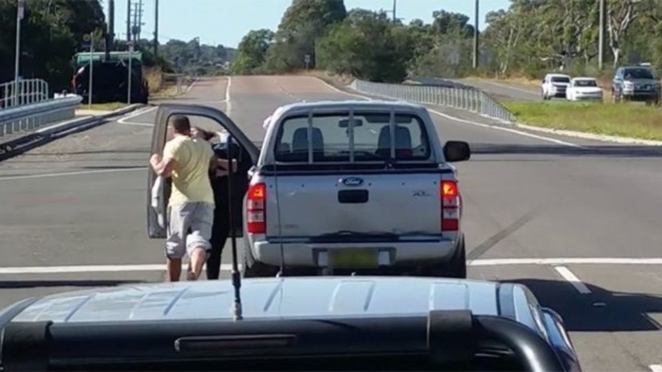 Woman charged after she was allegedly hit in NSW road rage attack