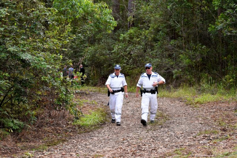 Police search dense bushland for evidence of the missing boy in March, 2015.