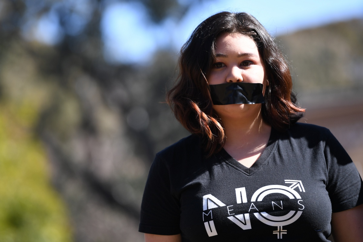 A university student is pictured protesting at the Australian National University in Canberra on Tuesday