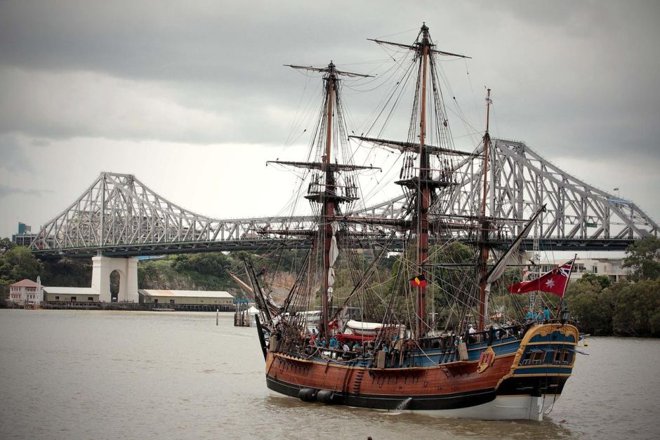 The Australian-built replica of Captain Cook's Endeavour arrives on the Brisbane River.