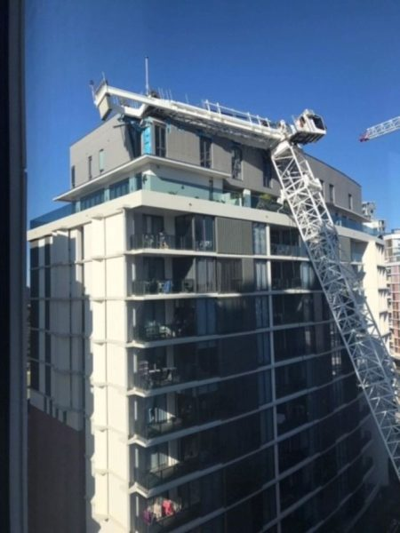 Crane falls on apartment block