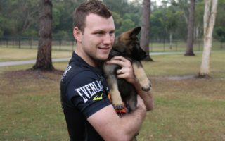 Jeff Horn holds Hornet the dog