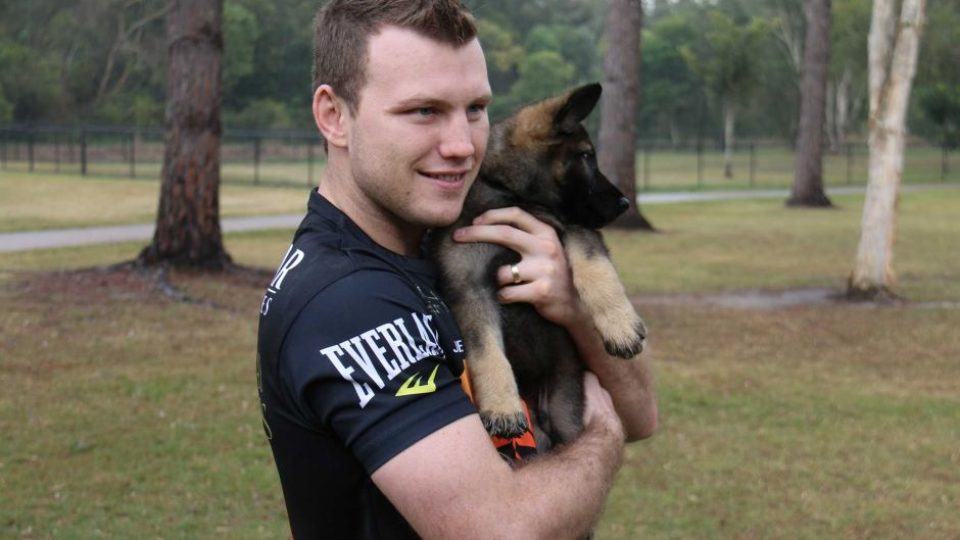 Jeff Horn holds Hornet the dog