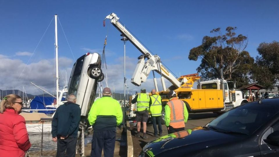 Jim McCrary's car is pulled out of the water at Triabunna