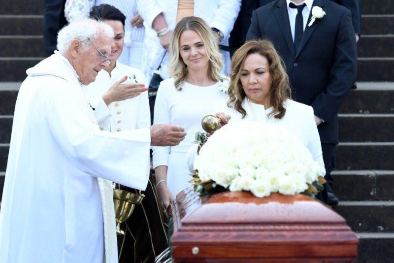 Les Murray's partner blesses the casket